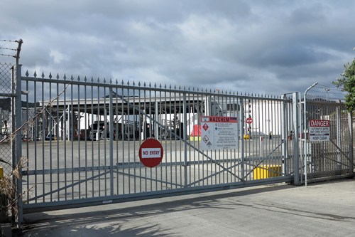 Cantilevered automatic gate industrial site