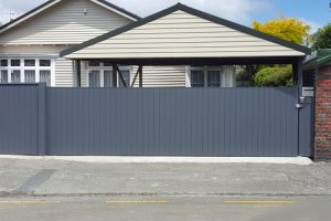 Sliding residential gate clad to match fence