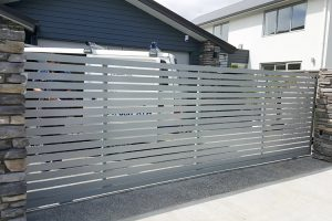 Residential sliding gate with aluminium slats